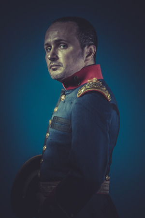 colonel: former general of the Spanish army, blue coat and gold epaulettes