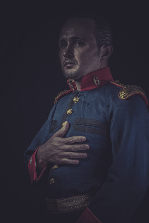 epaulettes: old soldier style jacket with blue and gold epaulettes, Spanish army