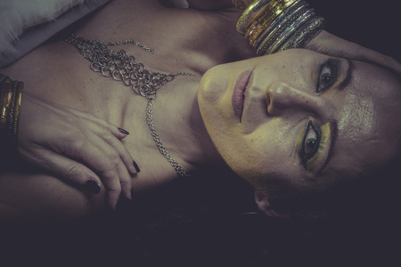 Elegance brunette woman with gold and silver jewelry photo