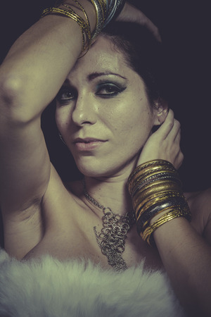 Style brunette woman with gold and silver jewelry photo