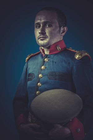 epaulettes: old-fashioned, general of the Spanish army, blue coat and gold epaulettes