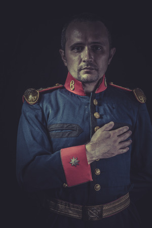 Peace, old soldier style jacket with blue and gold epaulettes, Spanish army Stock Photo