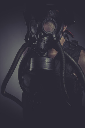 Worker, nuclear and toxicological disaster ,man with gas mask photo