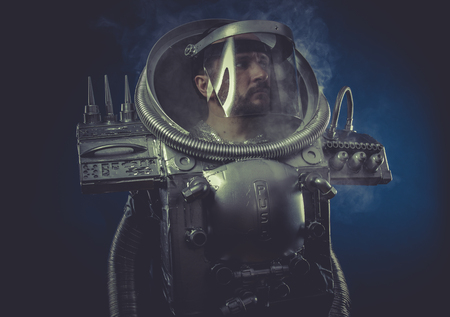 robot man in space armor silver photo