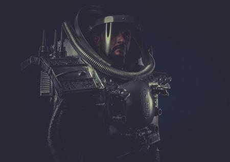 Serious, robot man in space armor silver photo