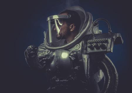 Metal robot man in space armor silver photo