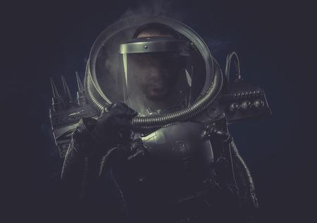 Techno, robot man in space armor silver photo