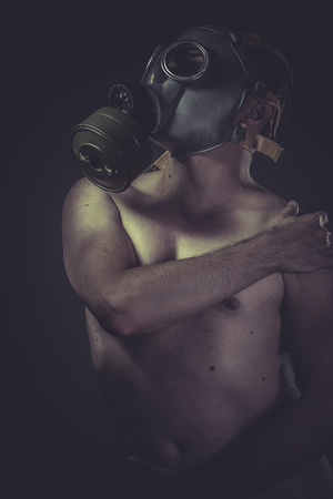 man with gas mask, pollution concept photo