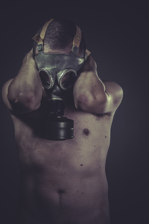 Ecology man with gas mask, pollution concept photo