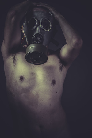 Environment, Nude man with gas mask, pollution concept photo