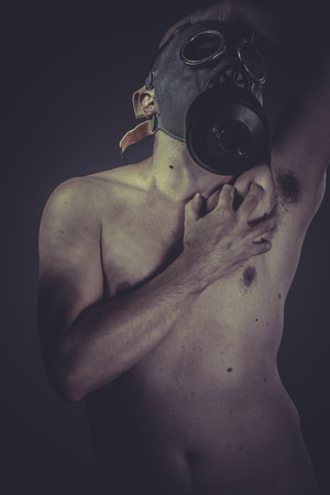 Nuclear, Nude man with gas mask, protection concept photo