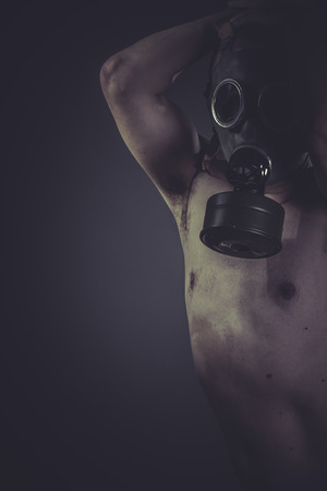 Nude man with gas mask, pollution concept disaster photo