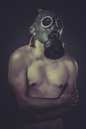 Nude man with gas mask, pollution concept photo