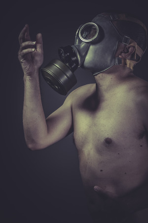 Nude man with gas mask, pollution concept protection photo