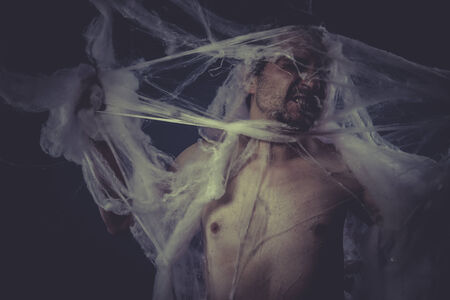 man trapped: Danger, Man trapped in a spider web