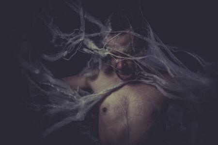 Dark Man trapped in a spider web photo