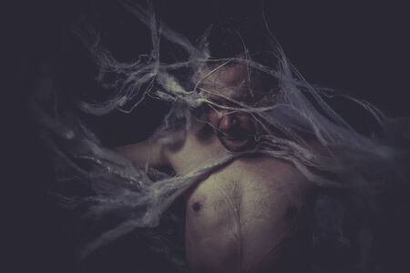 man trapped: Dark Man trapped in a spider web