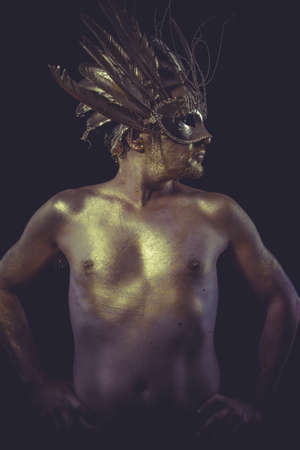 golden deity, man with wings and gold helmet photo