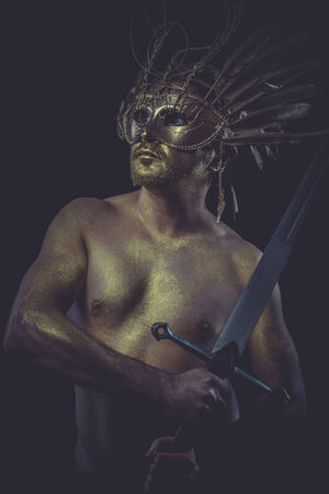 Protection, golden deity, man with wings and gold helmet photo
