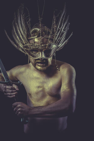 Hero, golden deity, man with wings and gold helmet photo