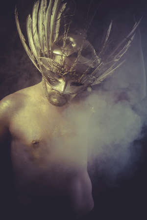 Nightmare, golden deity, man with wings and gold helmet photo