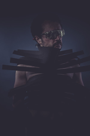grunge man suit made with black strips, concept horror and mystery photo