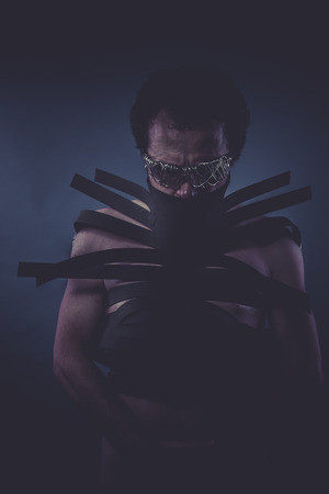 criminal man suit made with black strips, concept horror and mystery photo
