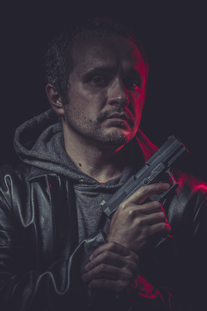 Danger, Assassin, man with black coat and gun photo