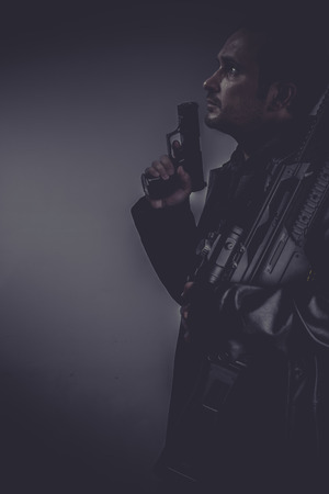 Detective, gangster with gun and pistol photo