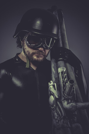 Fantasy, Future soldier with huge weapon, sci-fi scene photo
