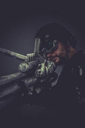 futuristic pistol: Futuristic. Starfighter with huge plasma rifle, fantasy concept, military helmet and goggles motorcyclist Stock Photo