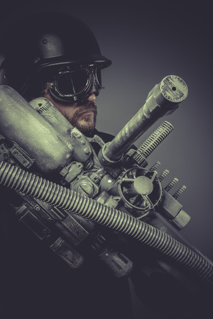 doomsday: Army fiction, Future soldier with huge weapon, sci-fi scene Stock Photo