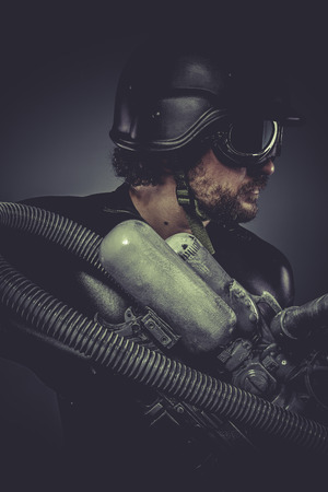 Future.Starfighter with huge plasma rifle, fantasy concept, military helmet and goggles motorcyclist photo