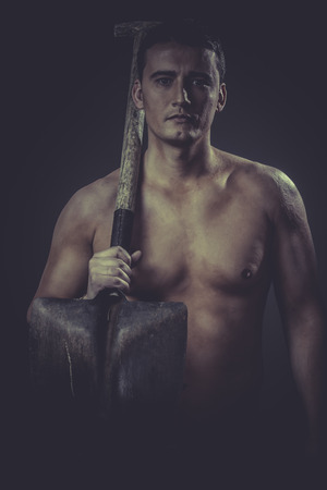 Occupation, Male worker holding a shovel, sexy builder photo