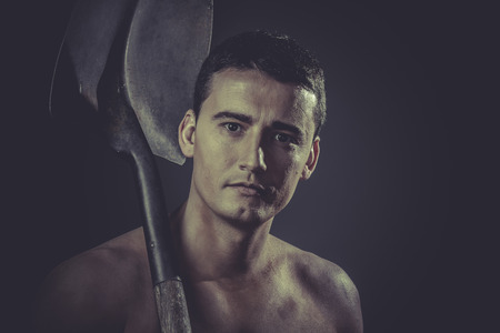 Industry, Male worker holding a shovel, sexy builder photo