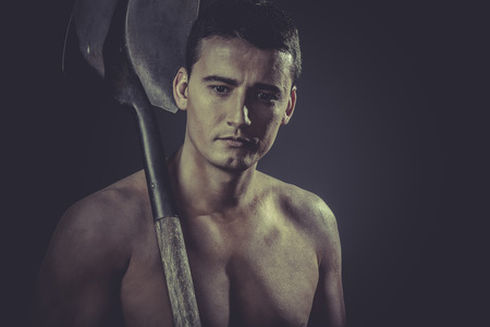 Farmer, Male worker holding a shovel, sexy builder photo