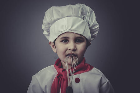 learning child dress funny chef, cooking utensils photo