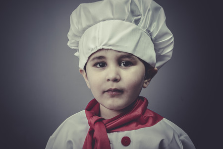 child dress funny chef, cooking utensils photo