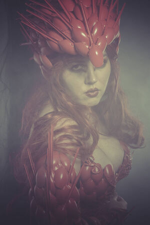 valkyrie: Princess Valkyrie war woman dressed in red armor and helmet dragon scales