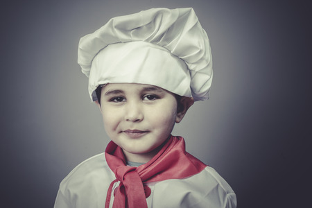 joy child dress funny chef, cooking utensils photo