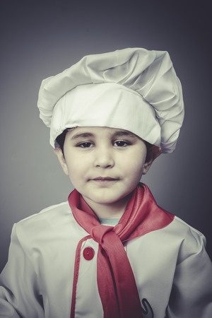 boy child dress funny chef, cooking utensils photo