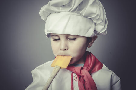 eating child dress funny chef, cooking utensils photo