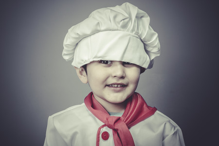 healthy child dress funny chef, cooking utensils photo