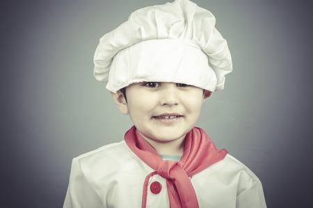 restaurant, child dress funny chef, cooking utensils photo