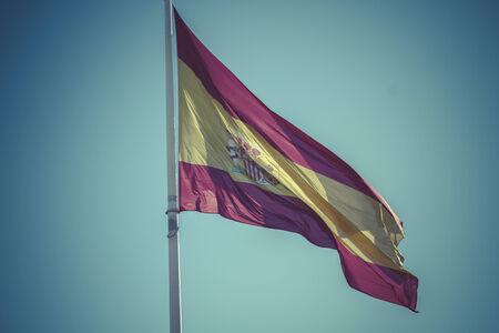 plaza: Spanish national flag. Plaza de Colon in Madrid, Spain.