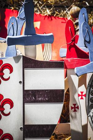 handmade wooden swords in a medieval fair photo