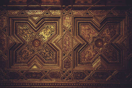 wood paneling: wood paneling covered with gold leaf Stock Photo