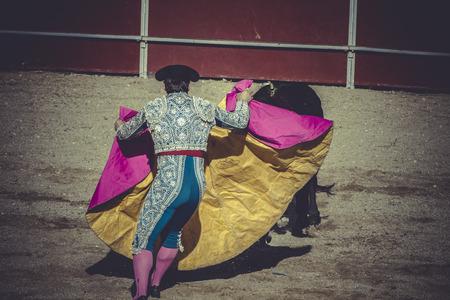 plaza de toros: pain, bullfight, traditional Spanish party where a matador fighting a bull Stock Photo