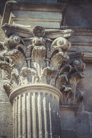Empire, Corinthian capitals, stone columns in old building in Spain photo