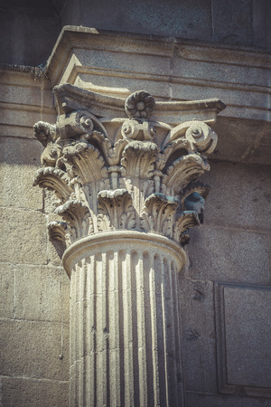 Rock, Corinthian capitals, stone columns in old building in Spain photo
